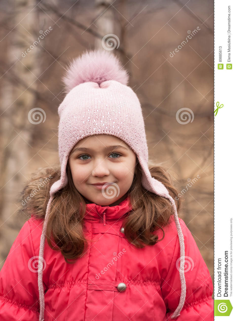 Little Girl In Bright Red Jacket And Knitted Pink Cap On Spring