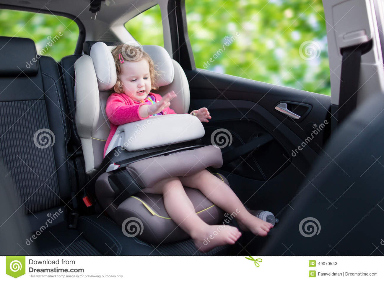 Little girl in car seat stock image. Image of modern - 49070543