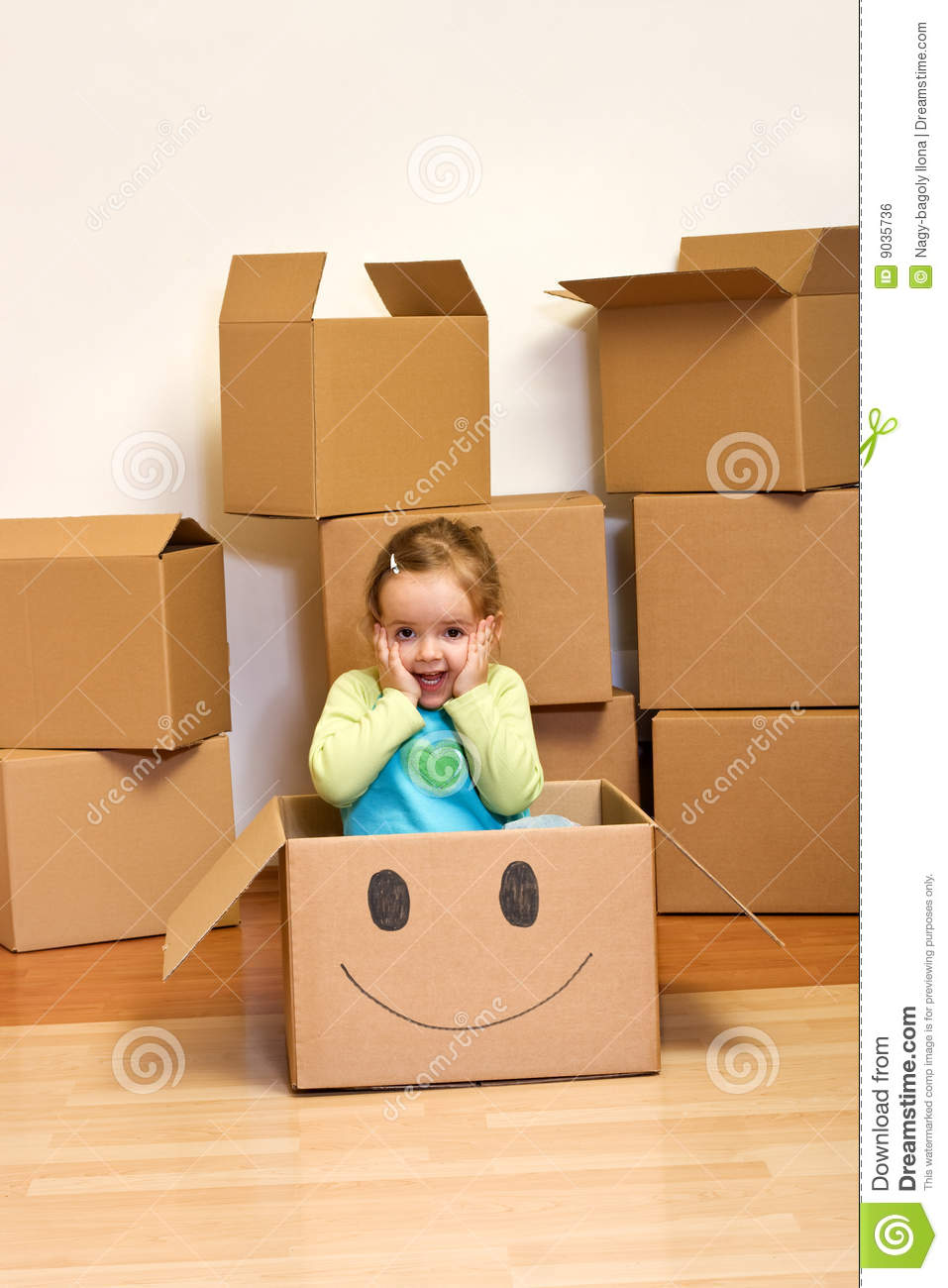 little girl in cardboard box moving concept stock photo image of indoor excited 9035736. Black Bedroom Furniture Sets. Home Design Ideas