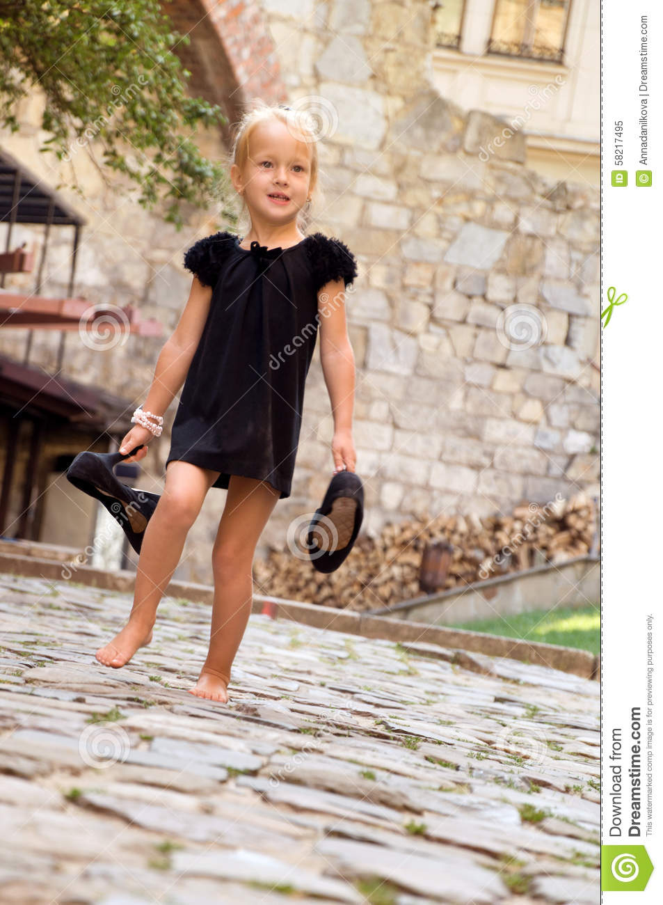Little Girl Goes Barefoot On The Road Royalty-Free Stock ...