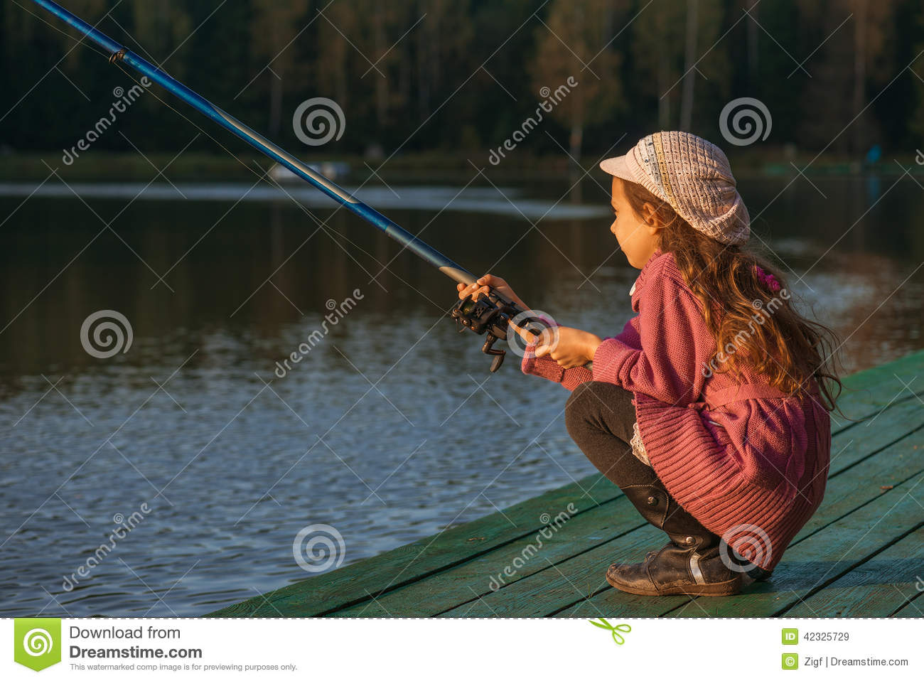 Little girl catches fishing rod stock photo image 42325729 for Little girl fishing pole