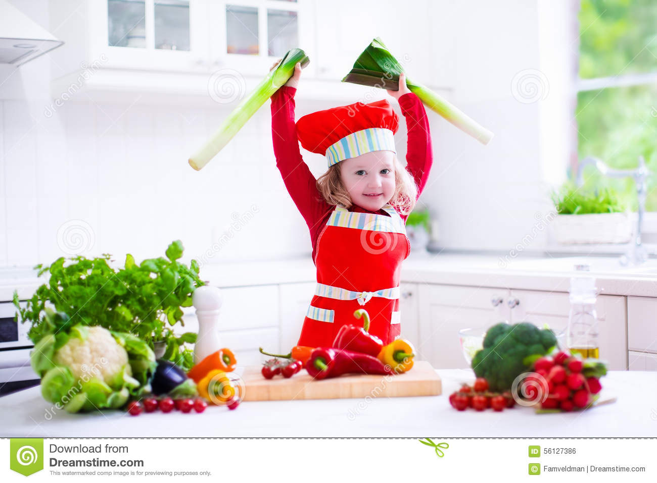 Little girl in chef hat preparing lunch stock photo for Fresh chef kitchen