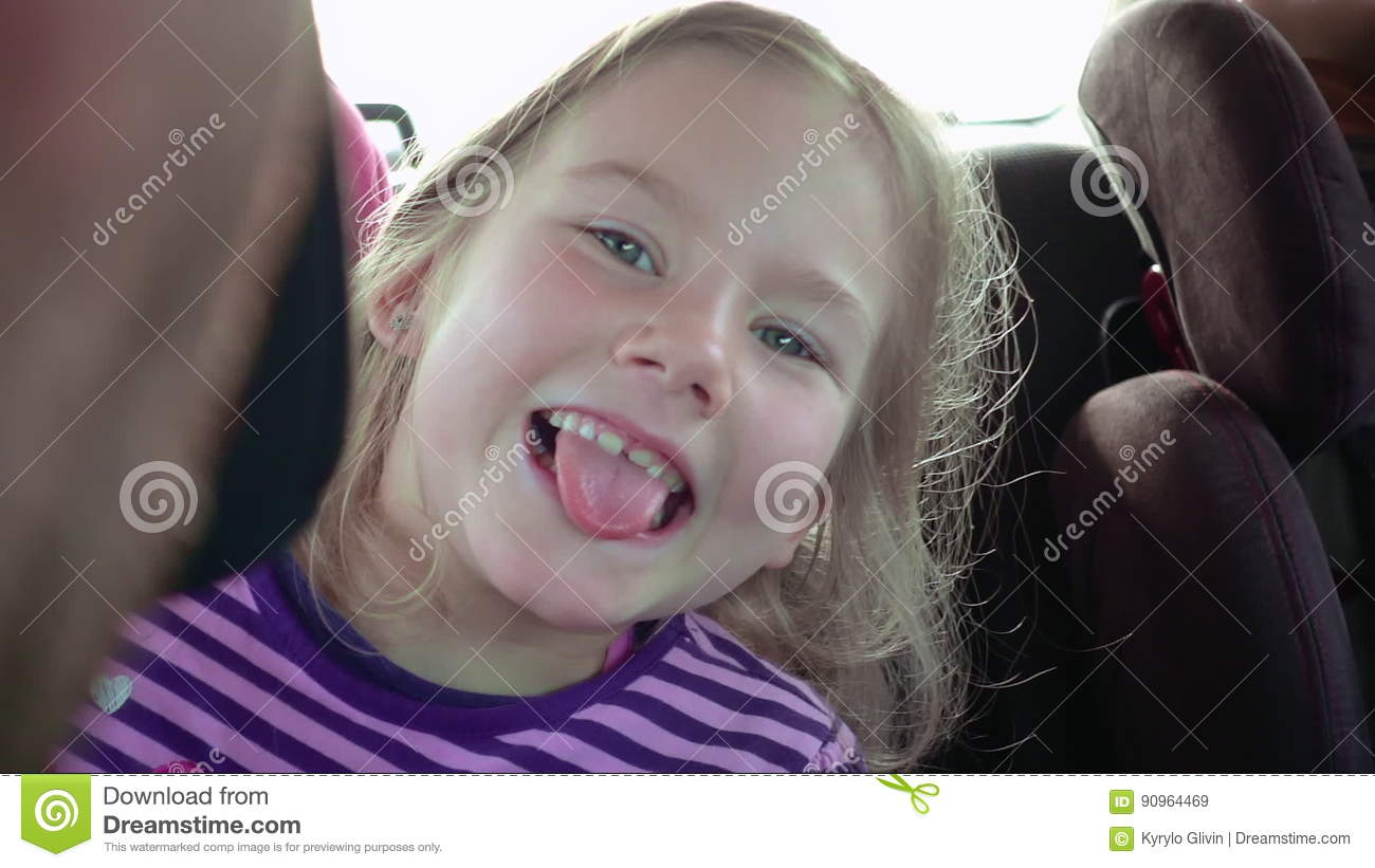 Little Girl In A Child Car Seat Smiles And Laughs Stock Video ...