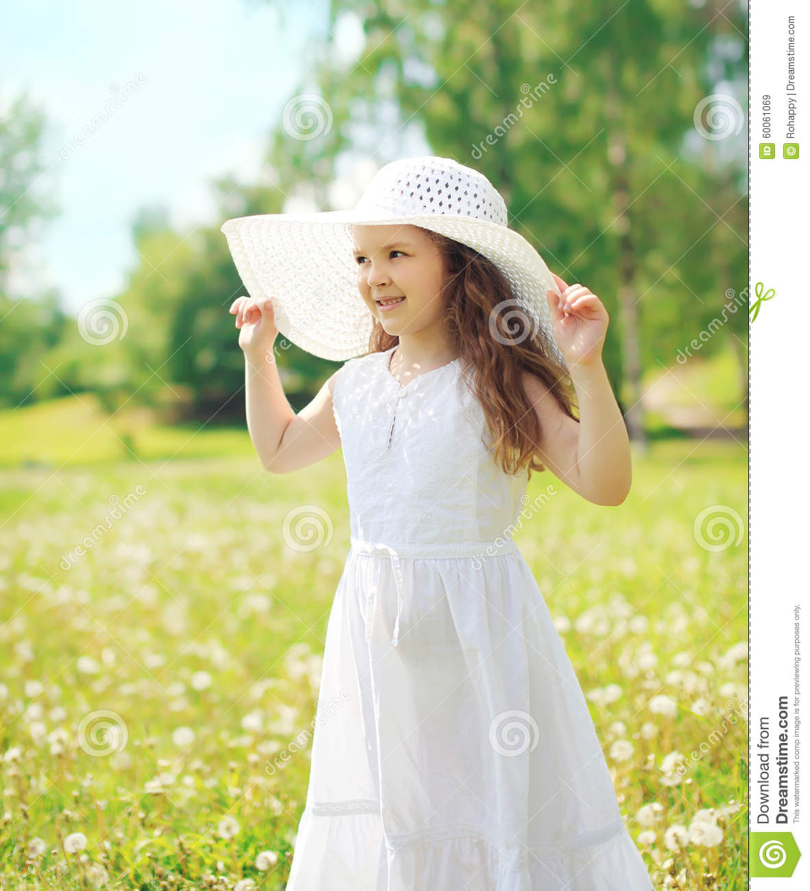 Little Girl Child Wearing A Straw Hat And White Dress In Summer ... f3c91ece1d6