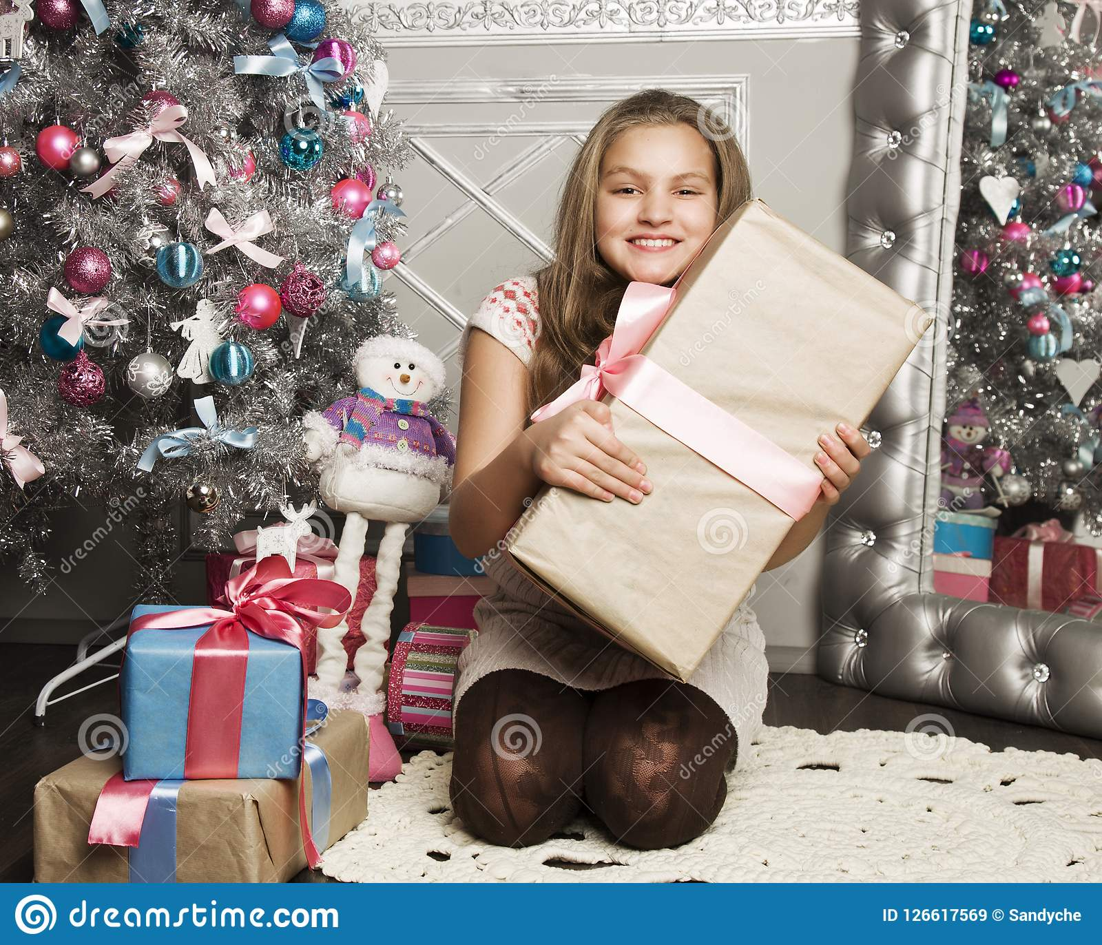 Little Girl With Christmas Gifts Near A Christmas Tree At Home Stock ...