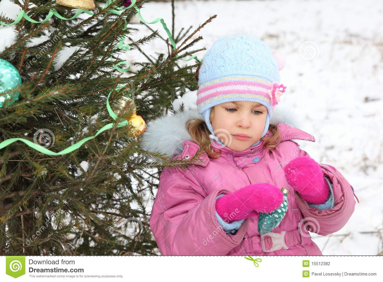 Little Girl With Christmas-tree Decoration Stock