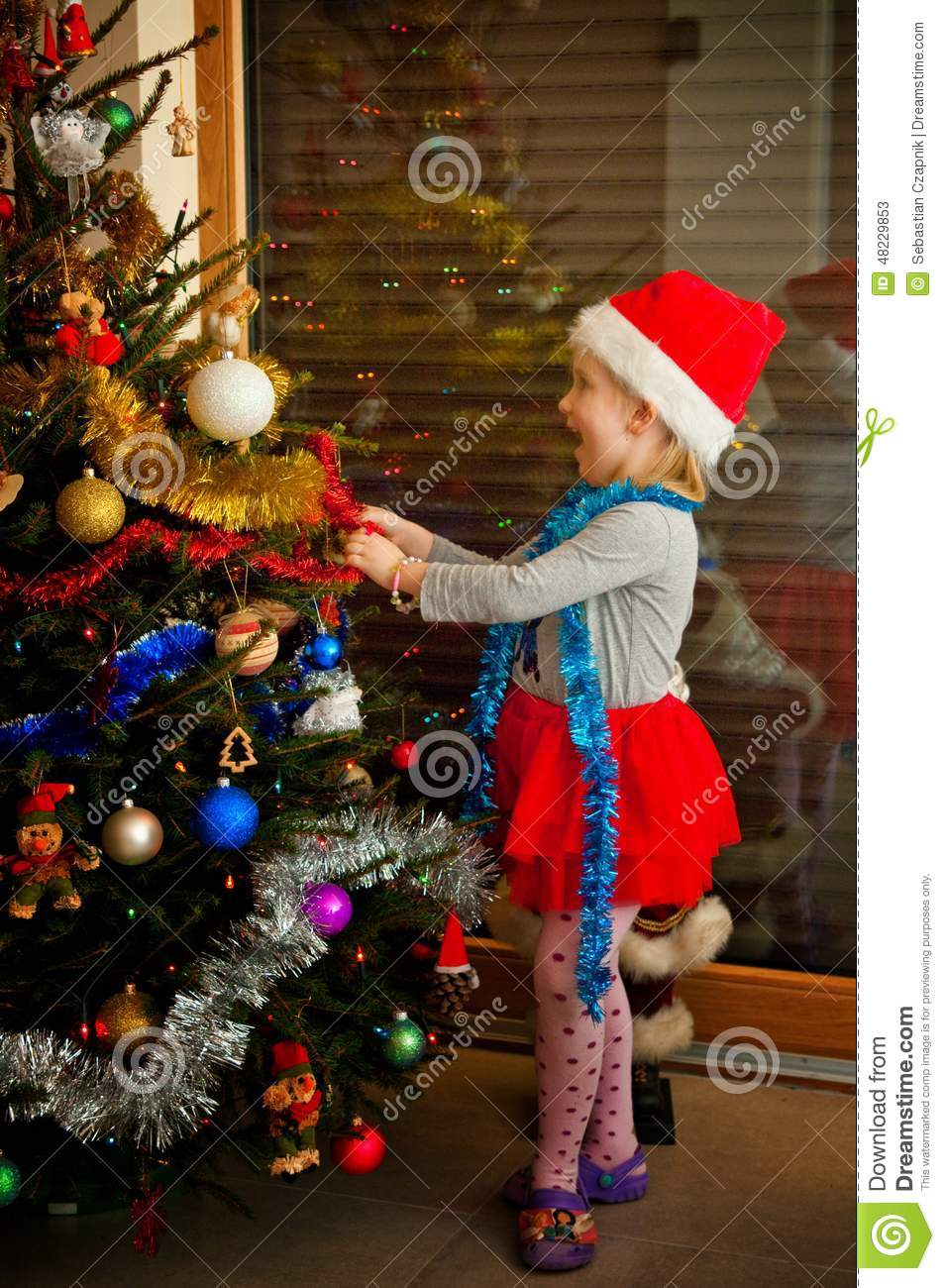 Little girl and christmas tree stock photo image 48229853 for Ideas for dressing a christmas tree