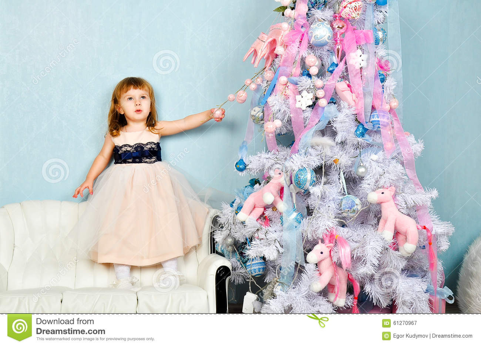 Little Girl And Christmas Tree Stock Photo