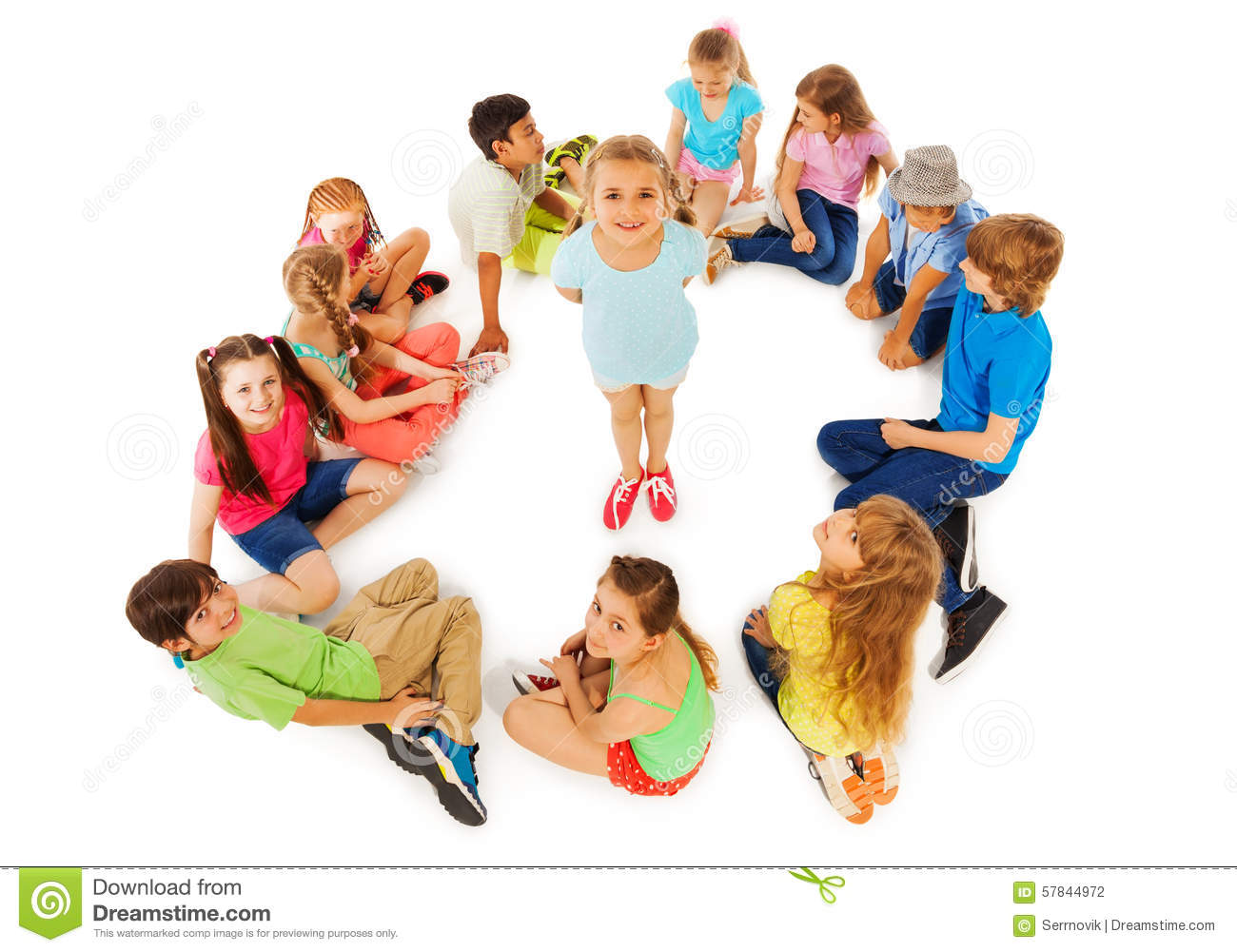 Little Girl In Circle Of Friends From Above Stock Photo
