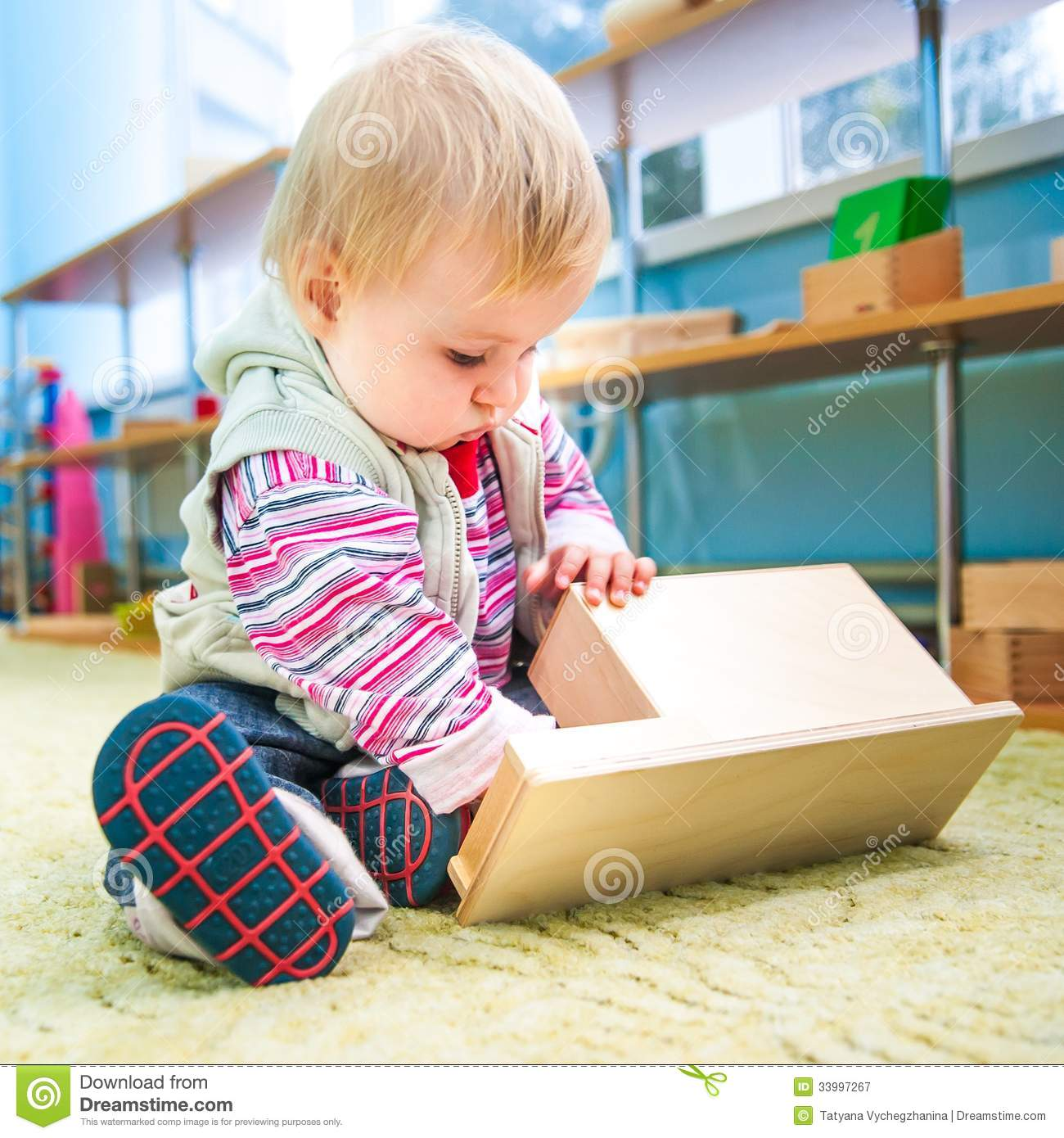 Adorable Little Girl Playing With Beach Toys During: Little Girl In The Classroom Early Development Stock Image
