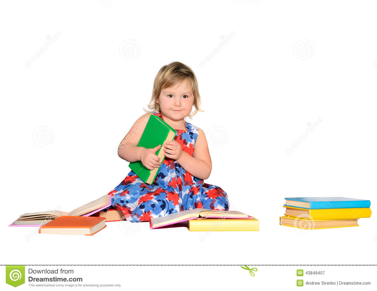 Little girl with colored books
