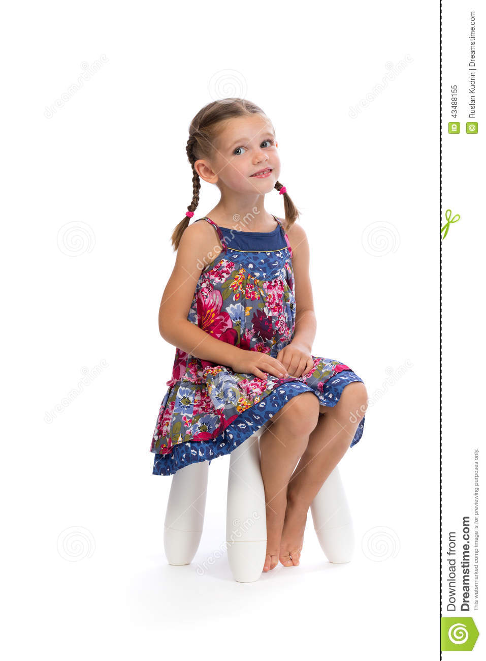 Little girl in a colored dress on a chair in the studio and shy stock image image 43488155 - Pics of small little girls ...