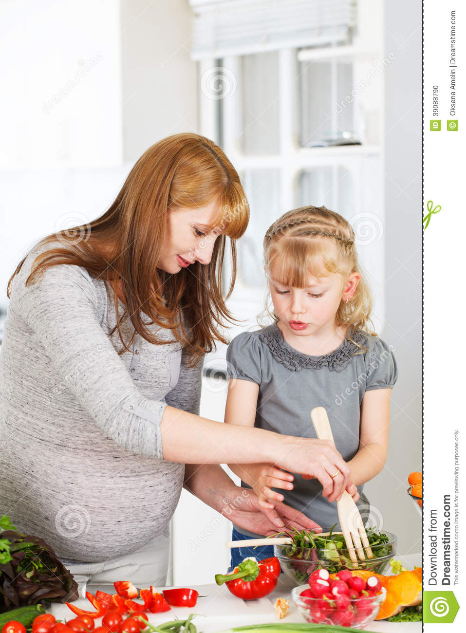 Little girl cooking with her mother