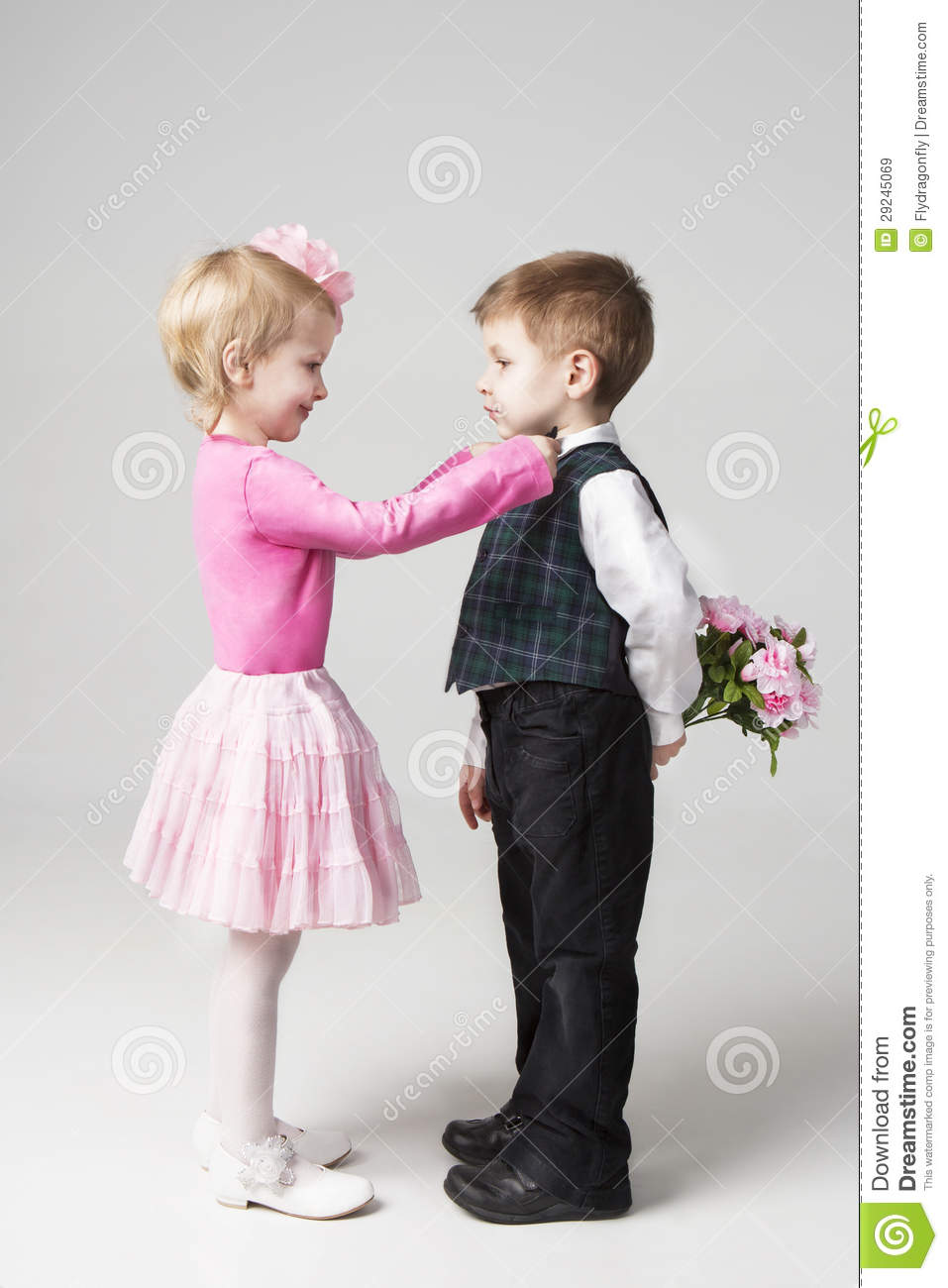 Little Girl Corrects Boy S Tie Stock Image Image 29245069