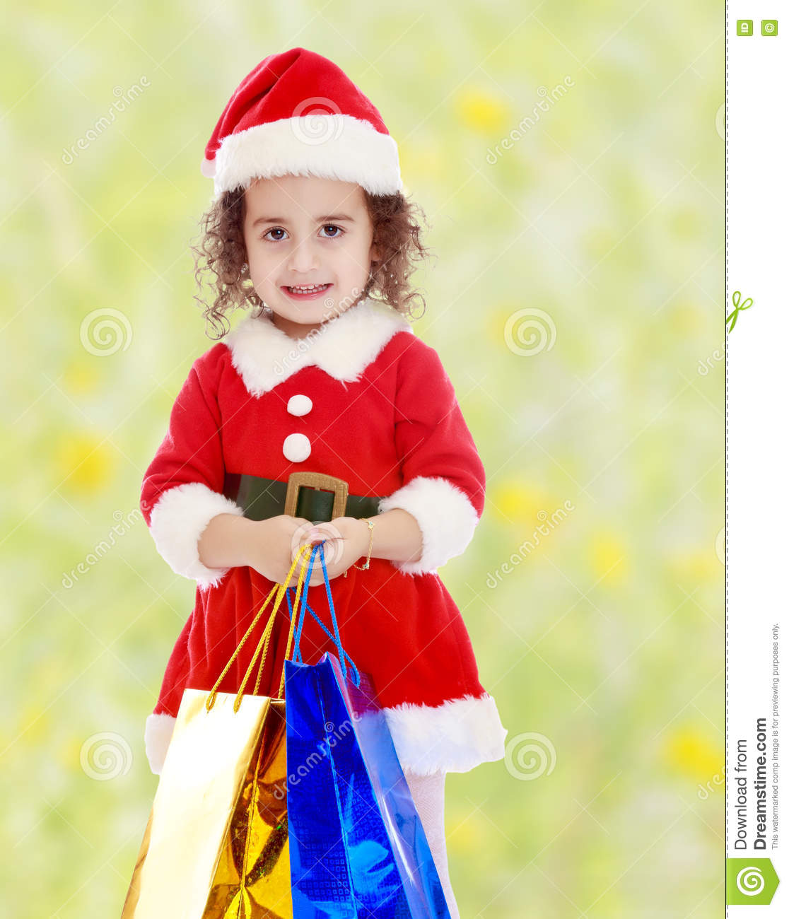 484626856 Little Girl In Costume Of Santa Claus With Colorful Packages Stock ...