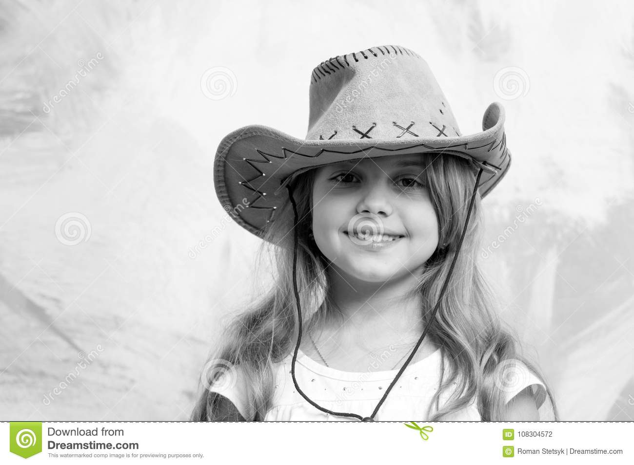 c12b1b38d1a46 Cowgirl. little girl in cowboy hat on colorful background