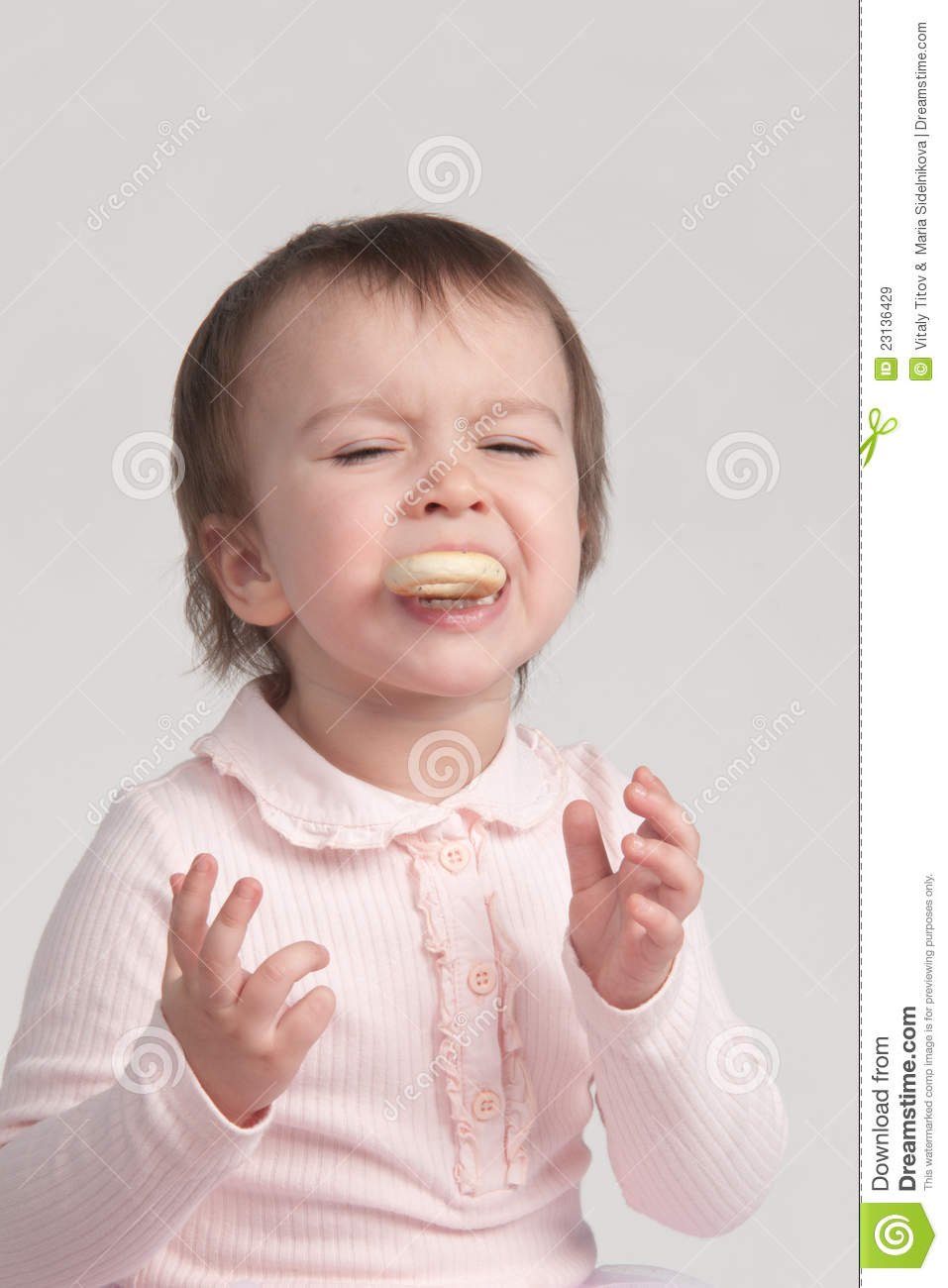 little girl crying eating cookies royalty free stock