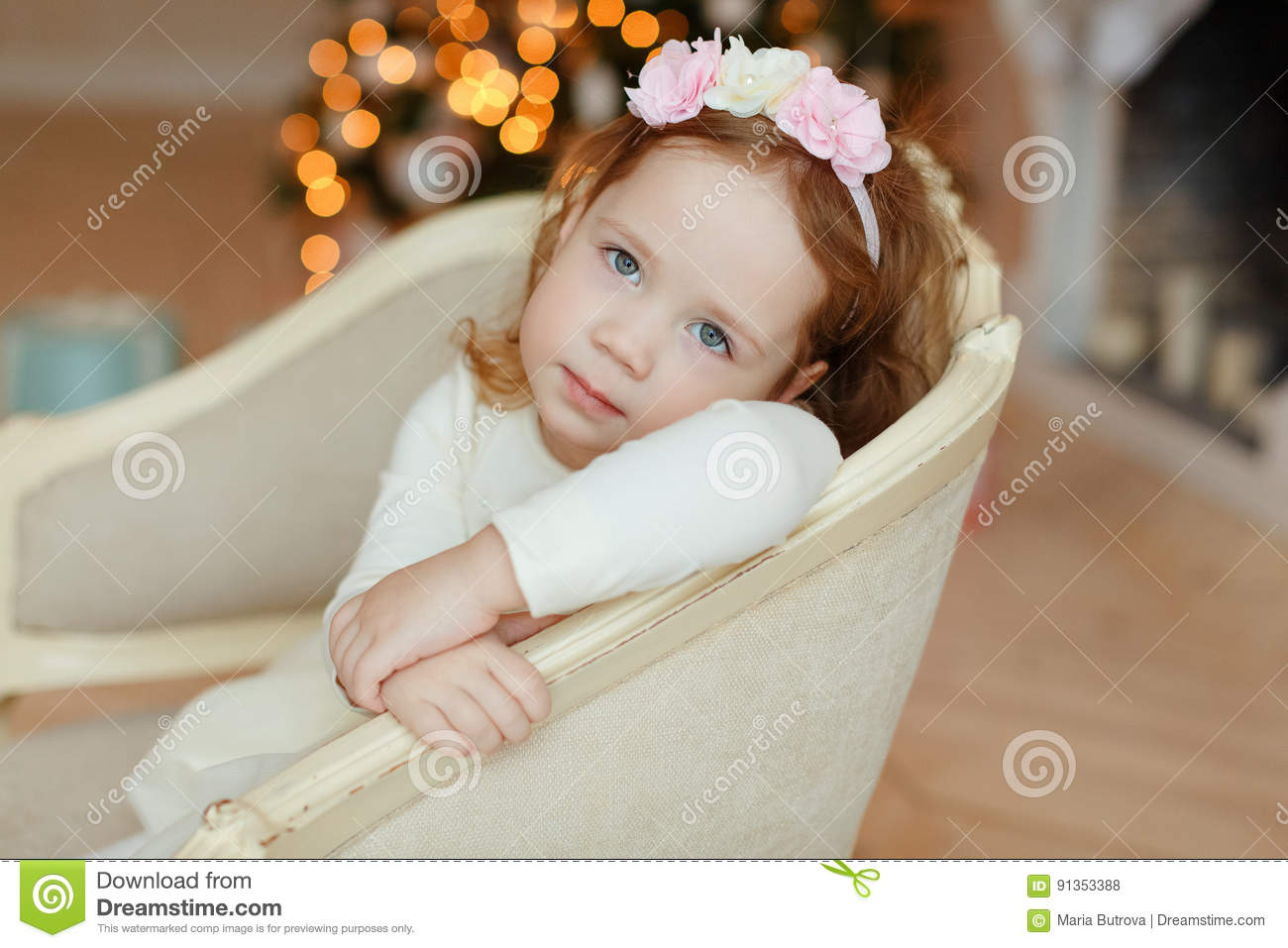 Little Girl Curly Baby Sitting In A Chair And Sad At Christmas Stock Photo - Image of indoor ...