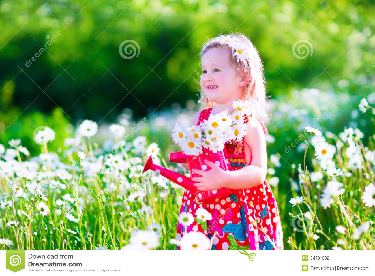 Little Girl In Daisy Flower Field Stock Photo
