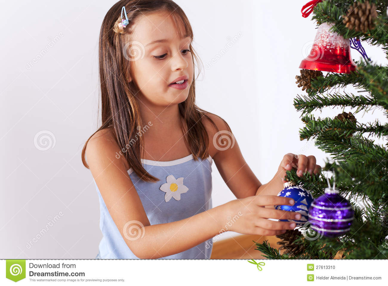 Little Girl Decorating A Christmas Tree Stock Photo