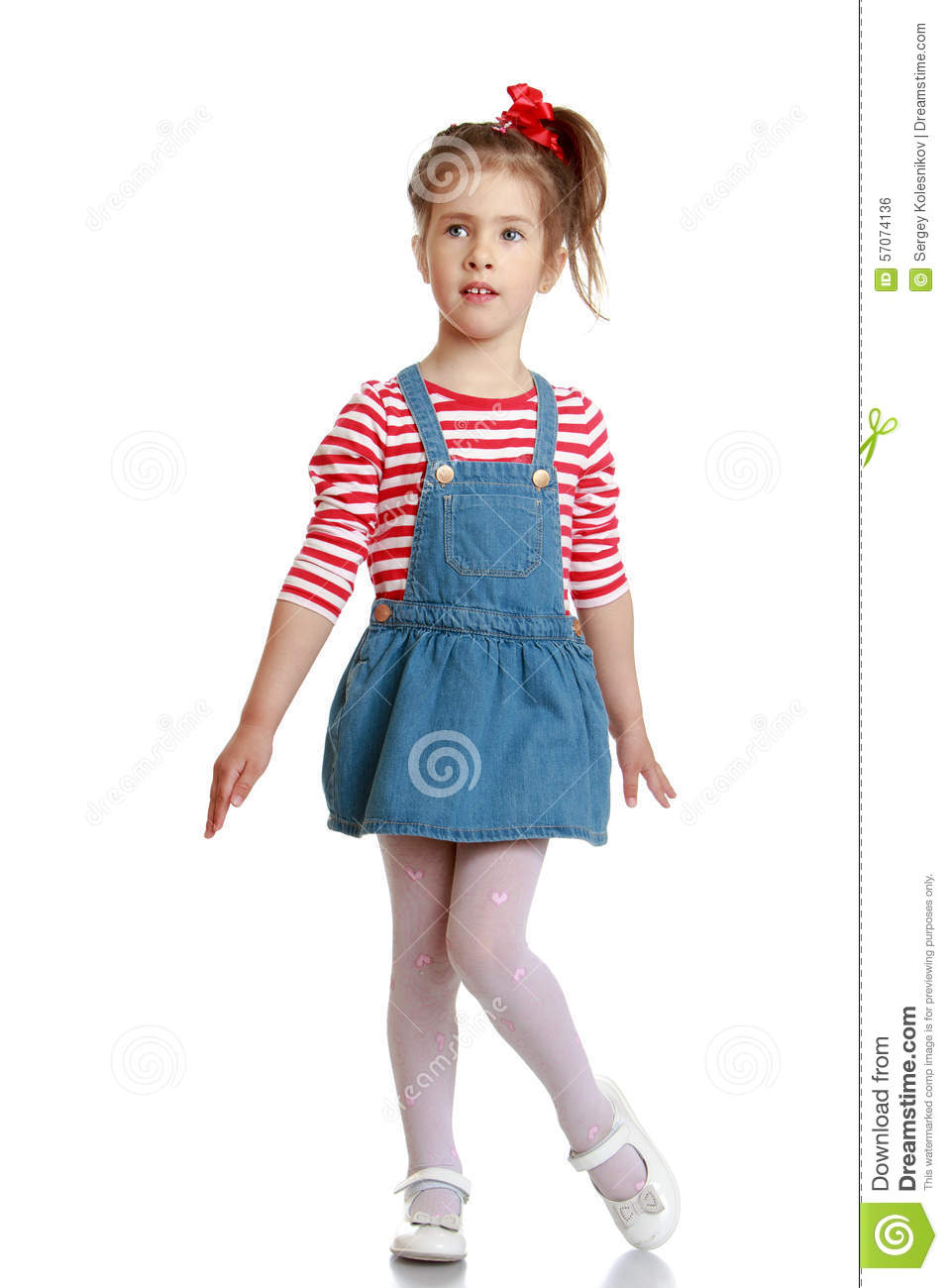 Little Girl In Denim Sundress Stock Photo - Image: 57074136