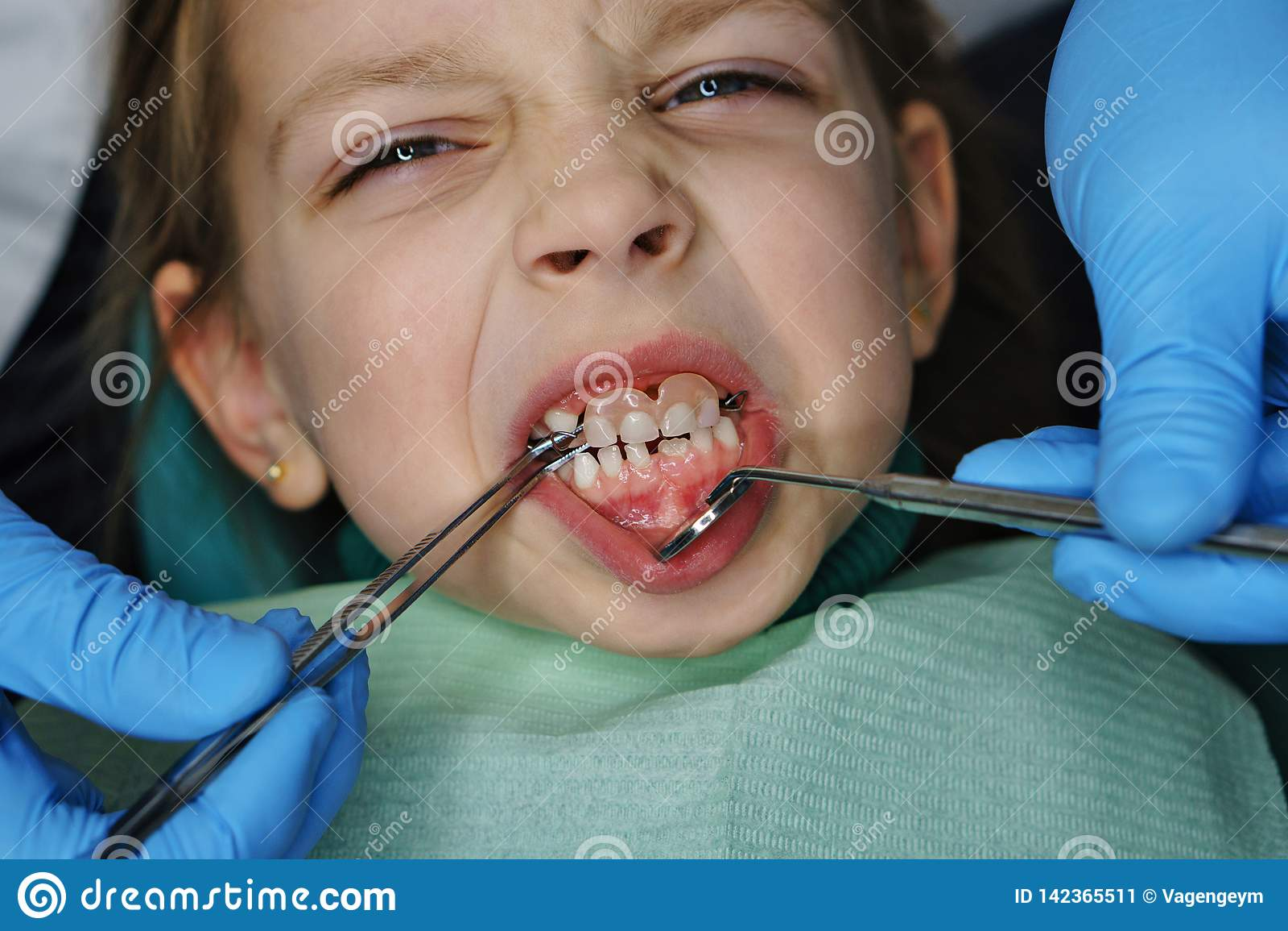 Little girl at dentist on examination