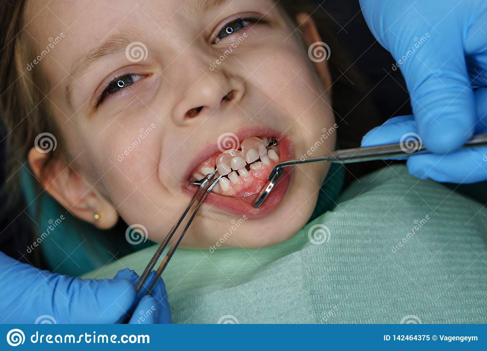 Little girl at dentist on examination