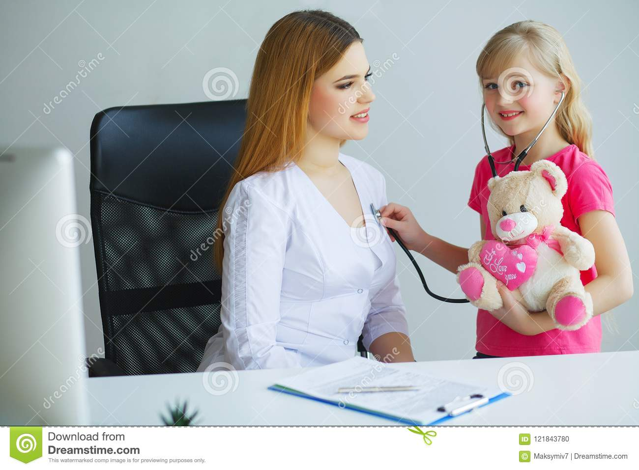 Little Girl At The Doctor For A Checkup Stock Photo