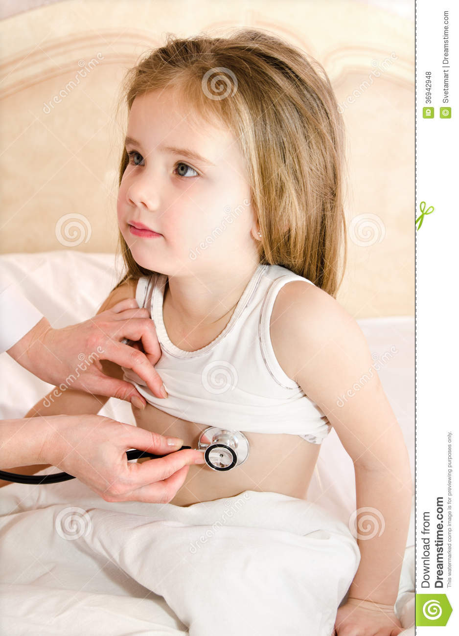 Little Girl At The Doctor For A Checkup Examination Stock