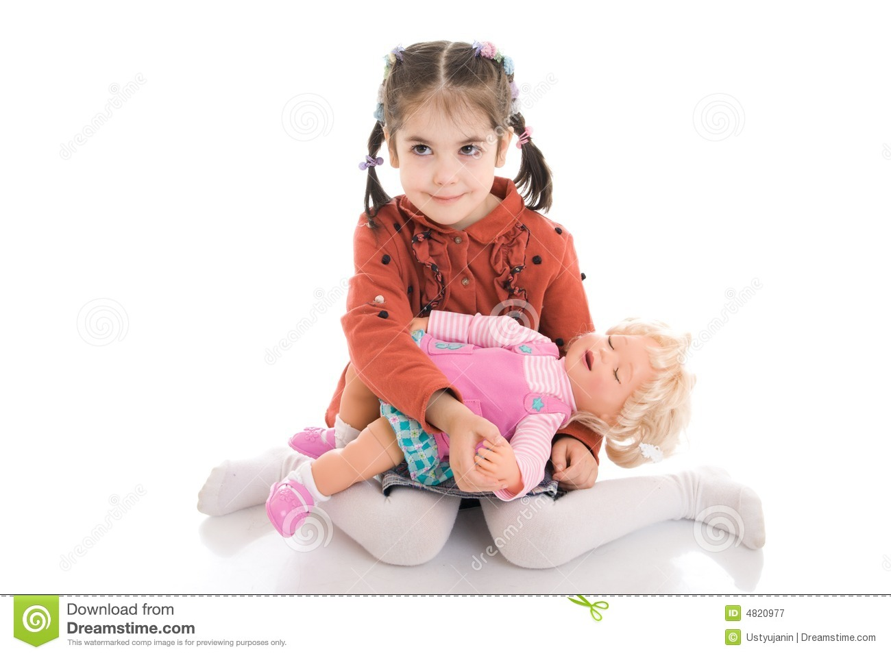 the little girl with a doll isolated on a white royalty