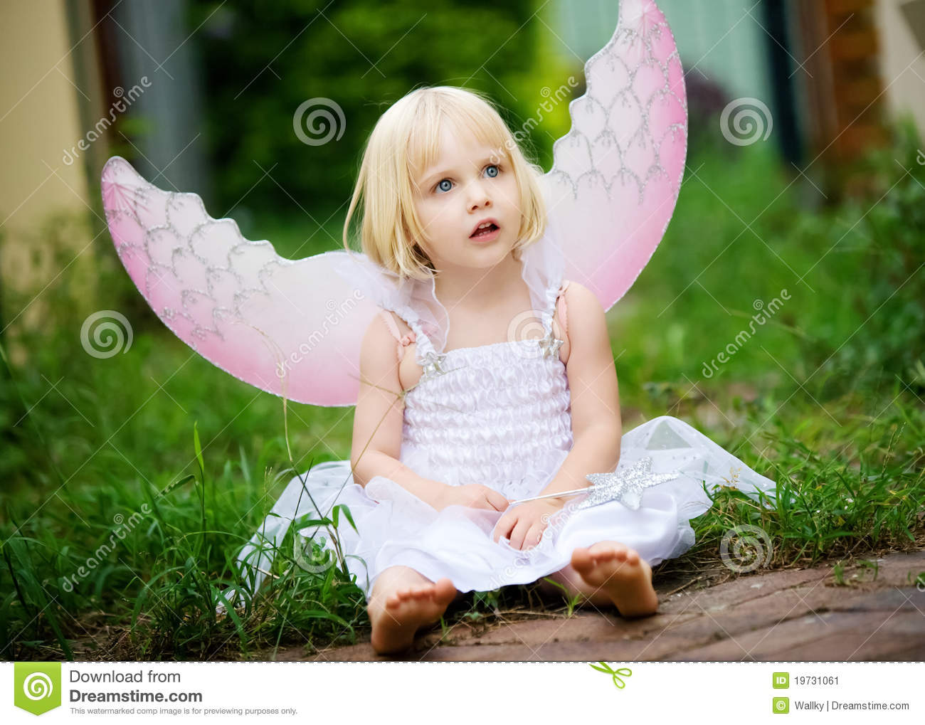 A Little Girl Dressed In A Angel Costume Stock Image