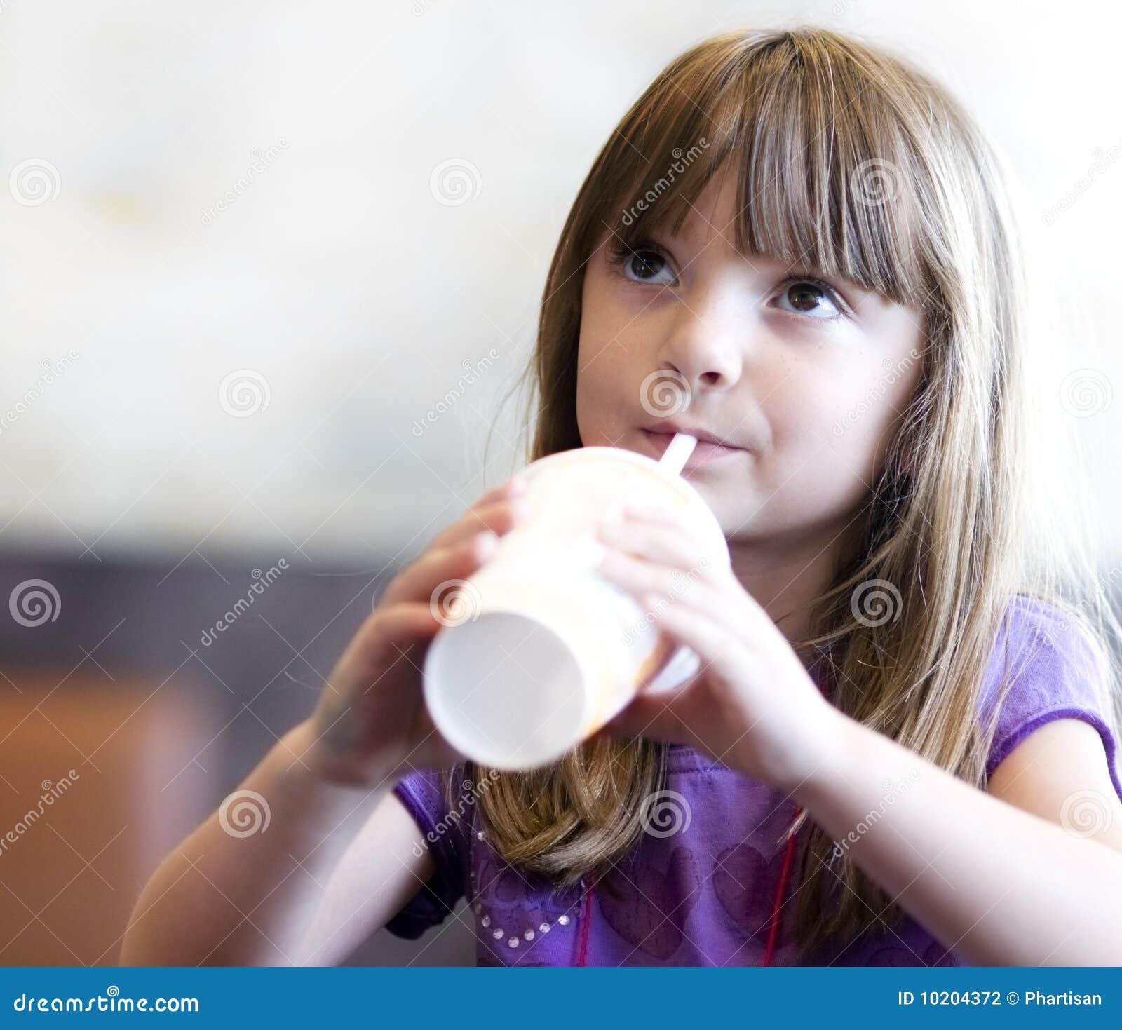 Little girl drinking soda pop