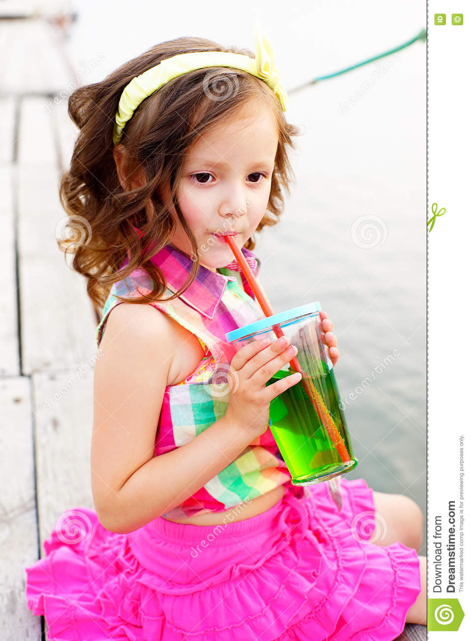Little Girl Drinking Sparkling Water On The Pier Stock ...