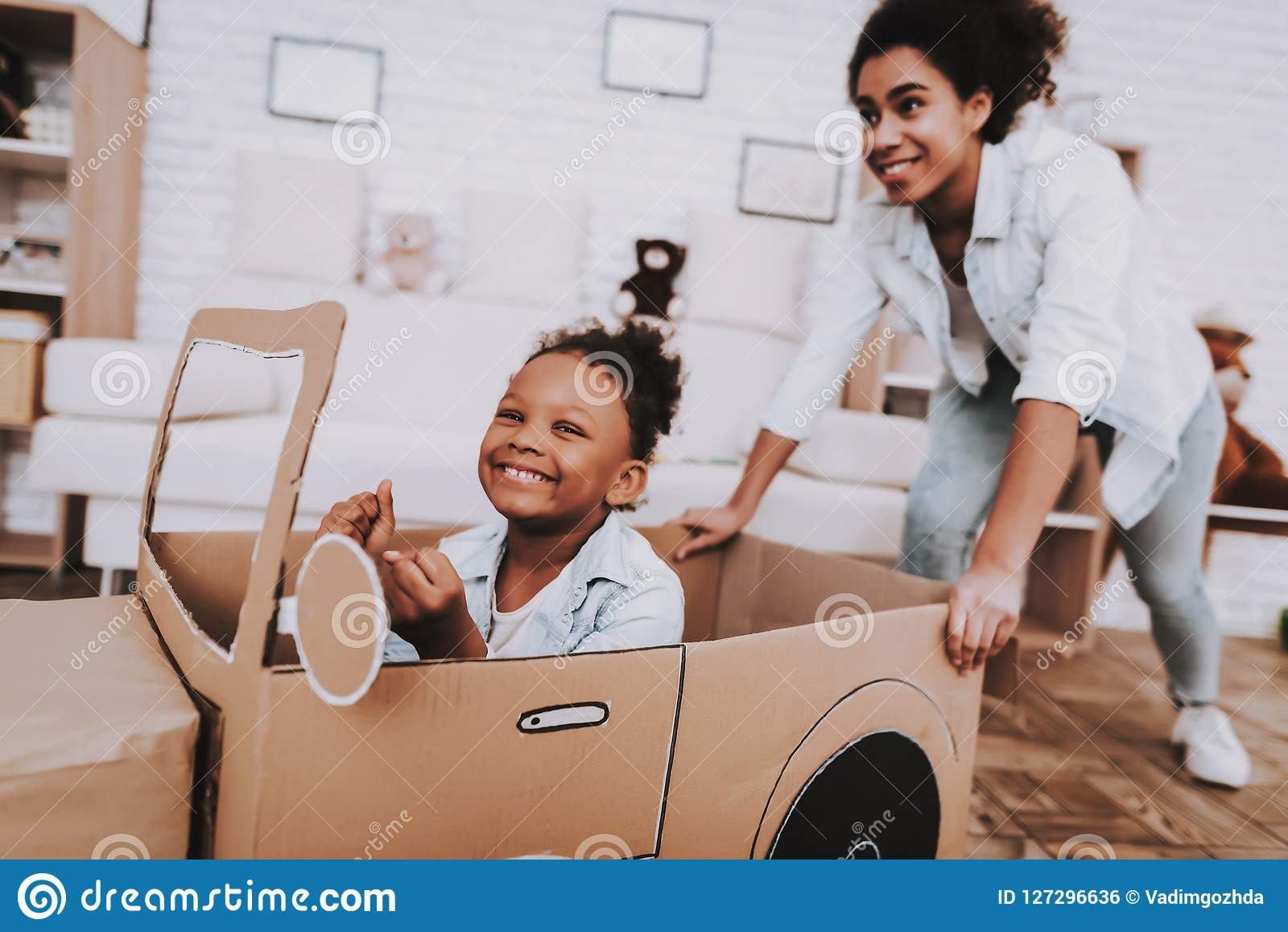 Little Girl Drive with Young Mother Like a Car.