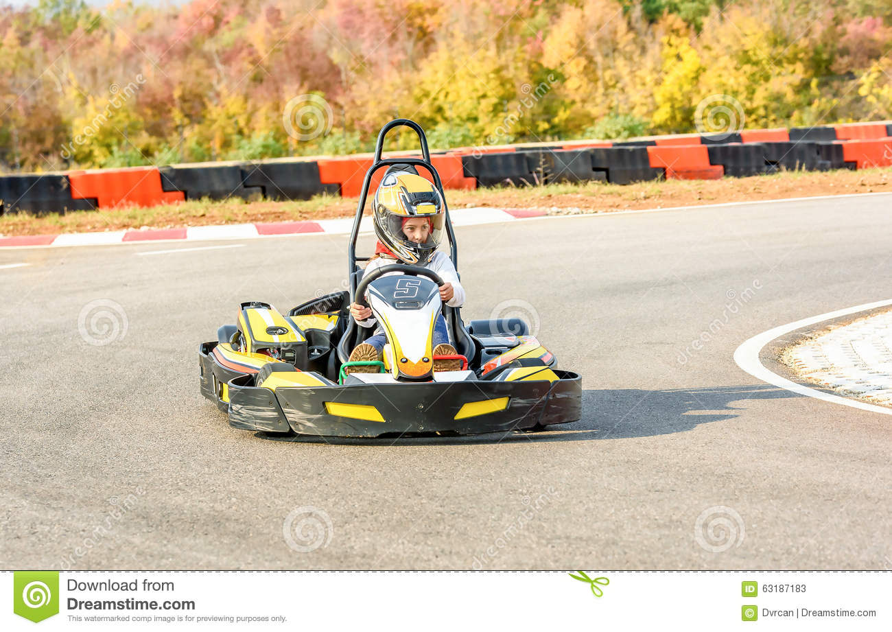 Little Girl Is Driving Go- Kart Car In A Playground Racing