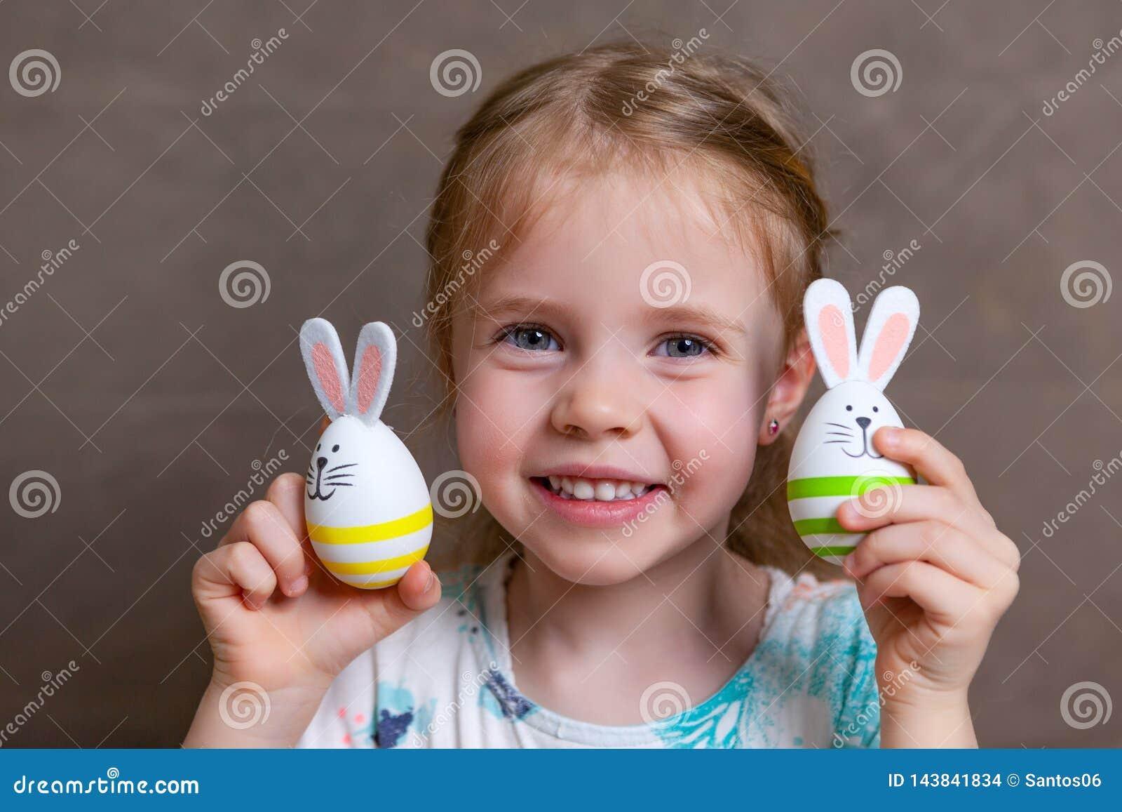 Little girl easter bunny eggs