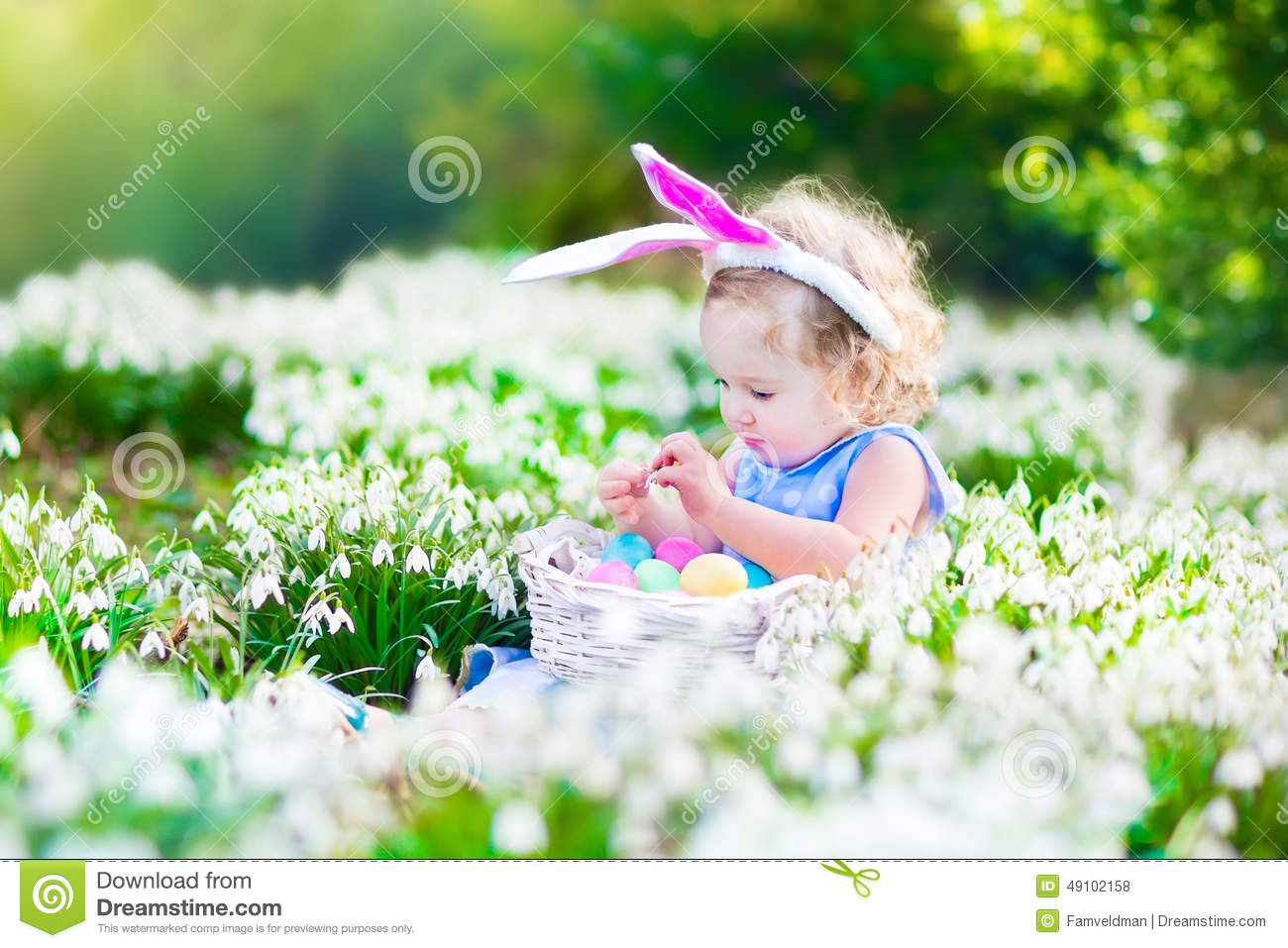 Boy And A Girl On An Easter Egg Hunt Royalty Free Stock