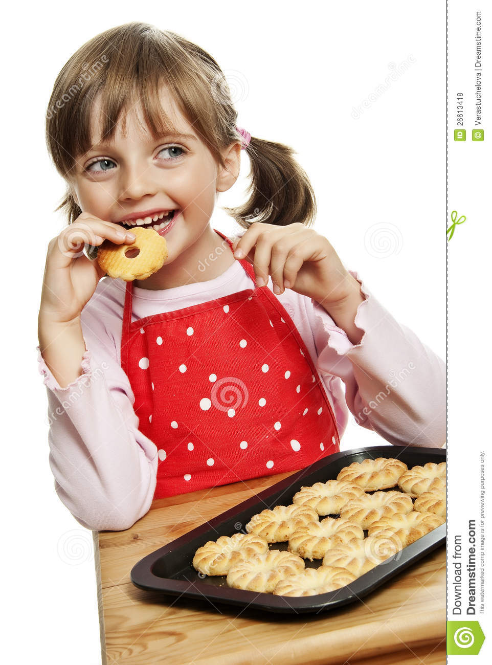 Little Girl Eating Cookies Royalty Free Stock Photos