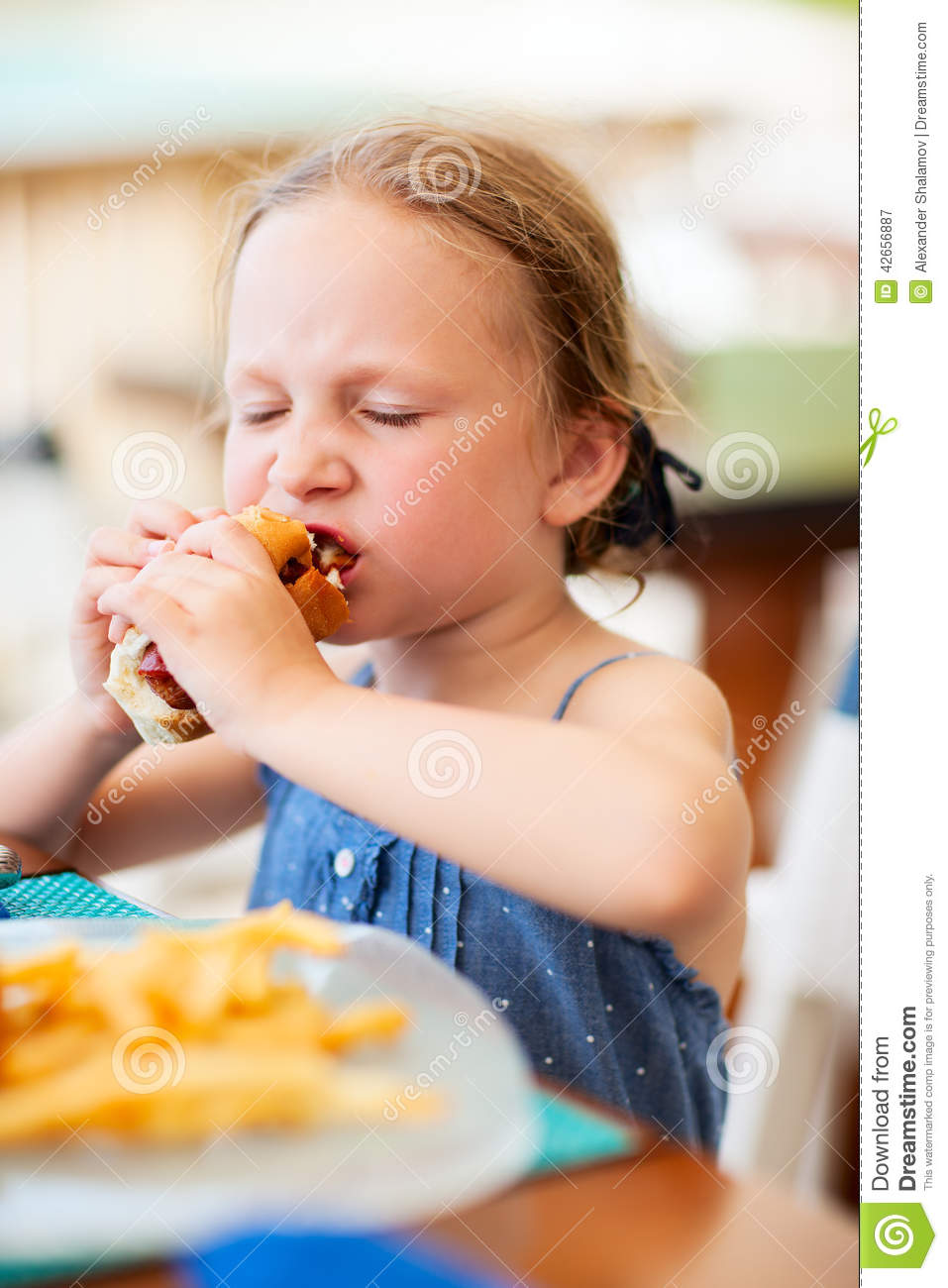Little Girl Eating Hot Dog Stock Image Image Of Enjoying