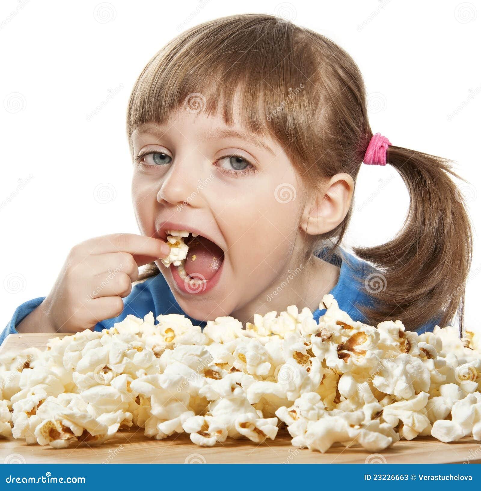 little-girl-eating-popcorn-23226663.jpg