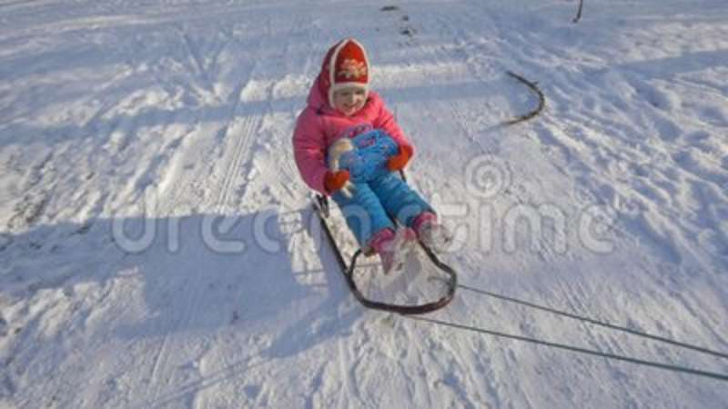 the child is riding a sled children play outdoors in snow stock footage video of toddler nature 103144610 - Christmas Vacation Sled