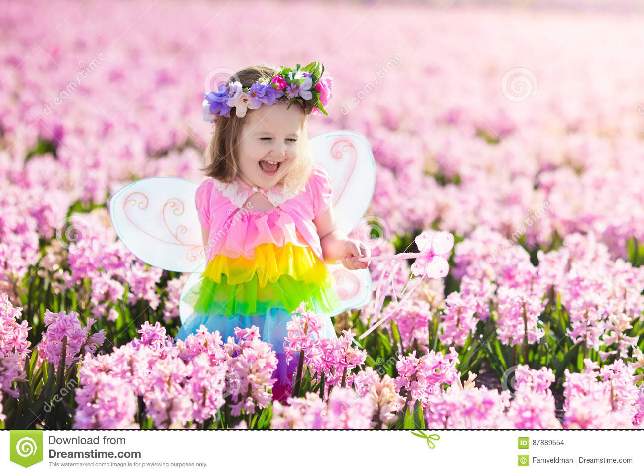 d3a8b3d4a346 Little Girl In Fairy Costume Playing In Flower Field Stock Photo ...