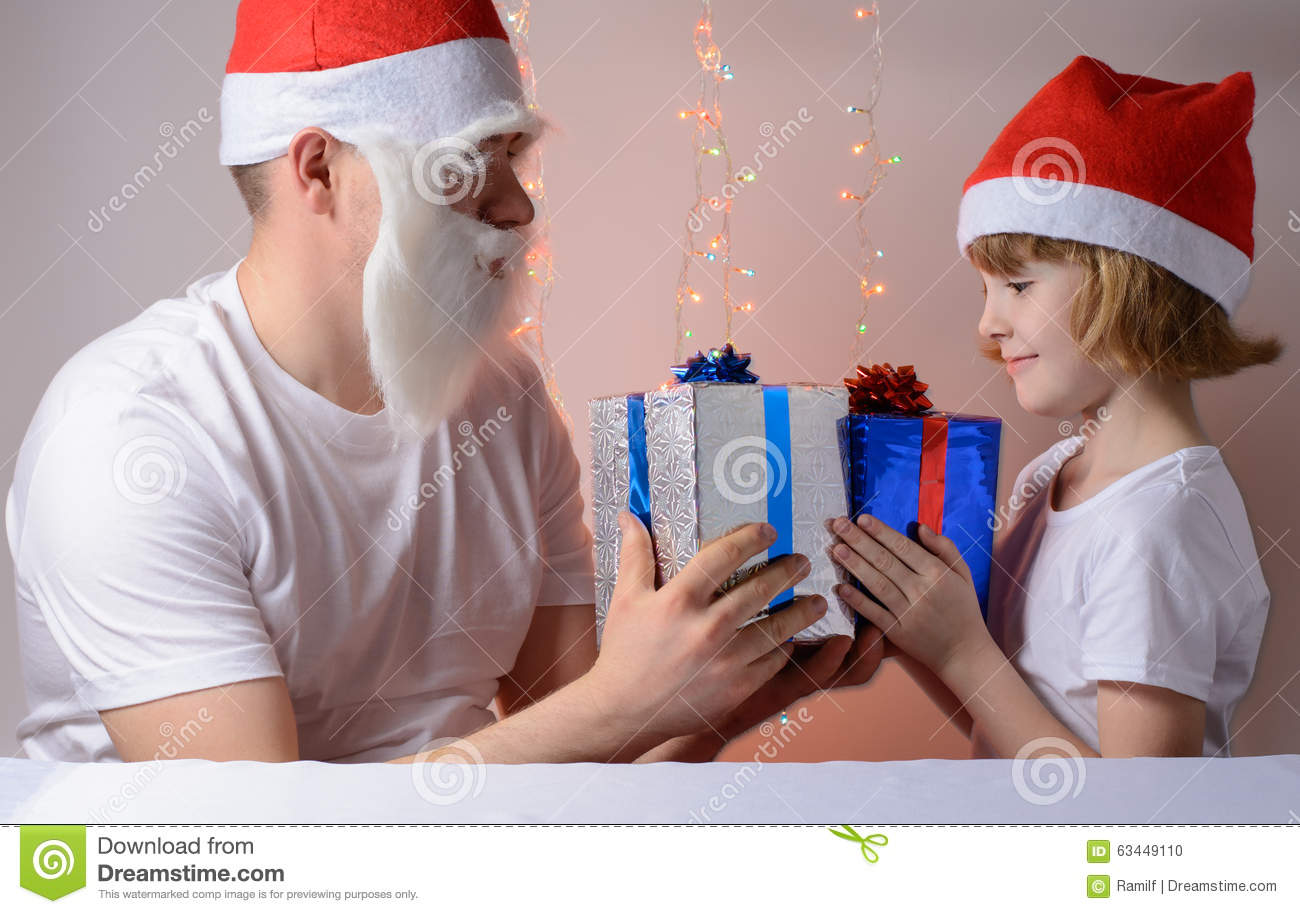 Little Girl And Father Christmas Gift Packs Stock Photo - Image of ...