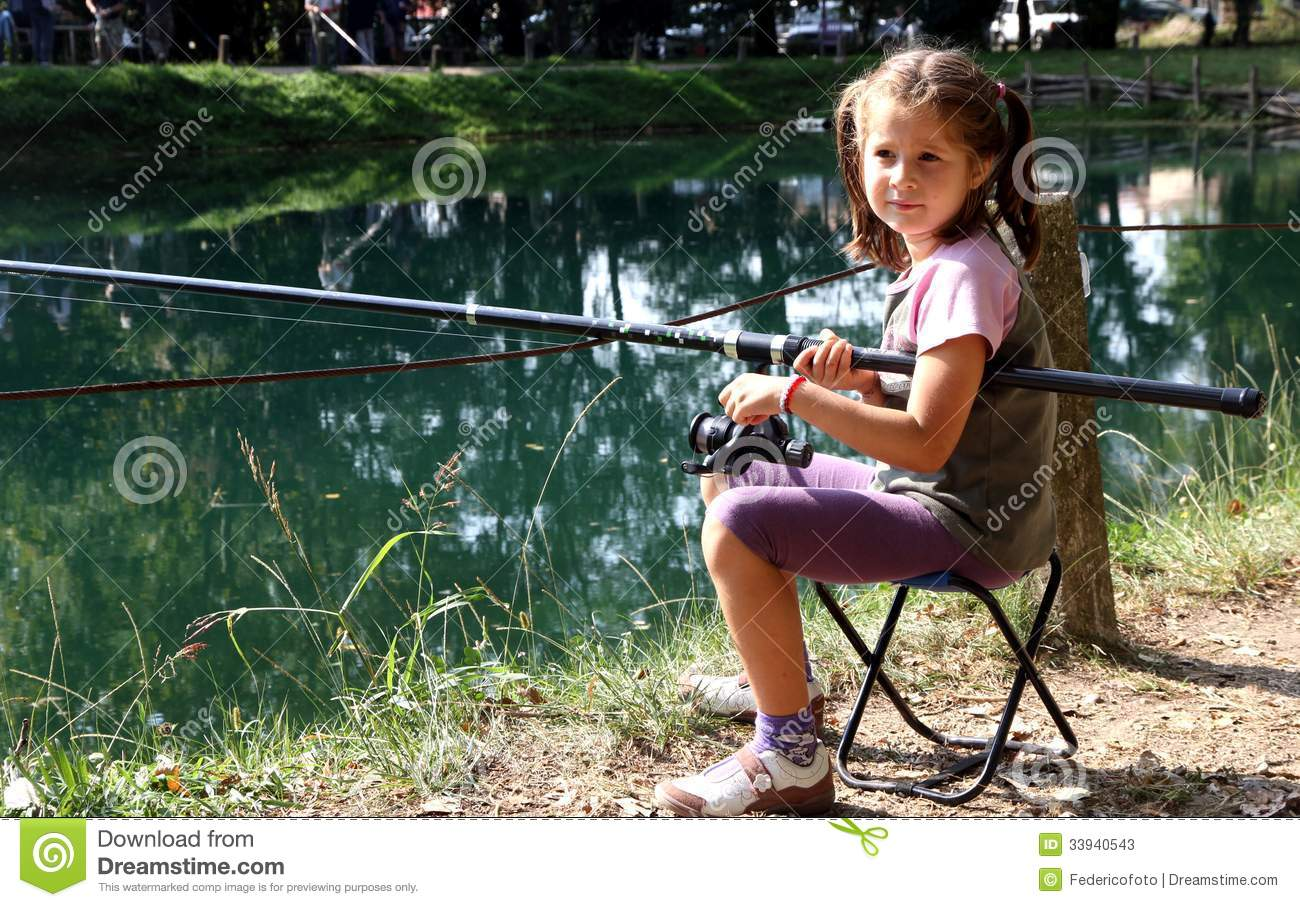 Little girl with the fishing rod on the shores of lake for Little girl fishing pole