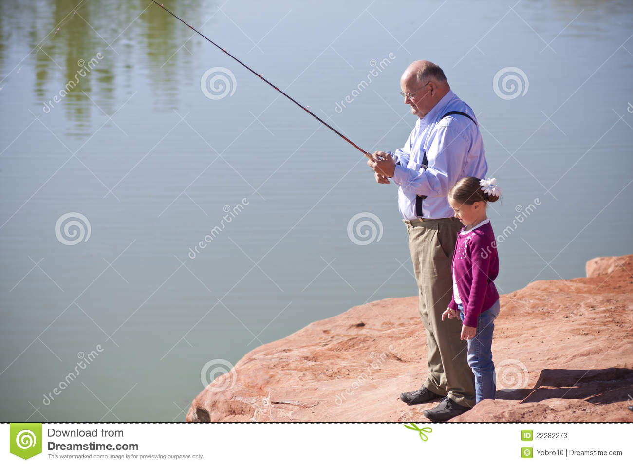 Little girl fishing together with grandpa stock image for Little girl fishing pole