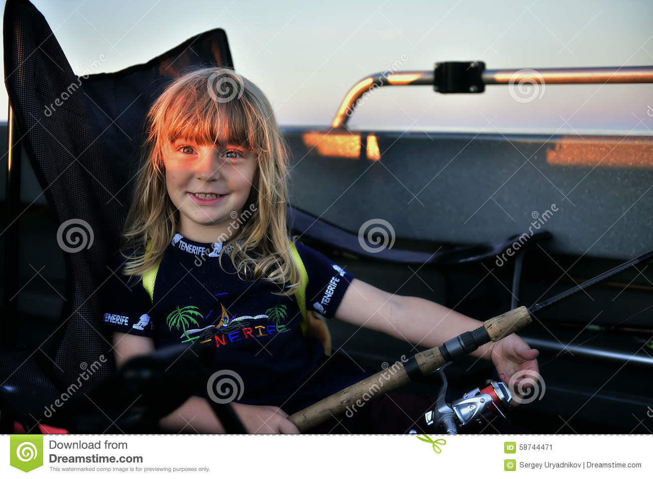 Child girl sailing in fishing boat holding rod royalty for Little girl fishing pole