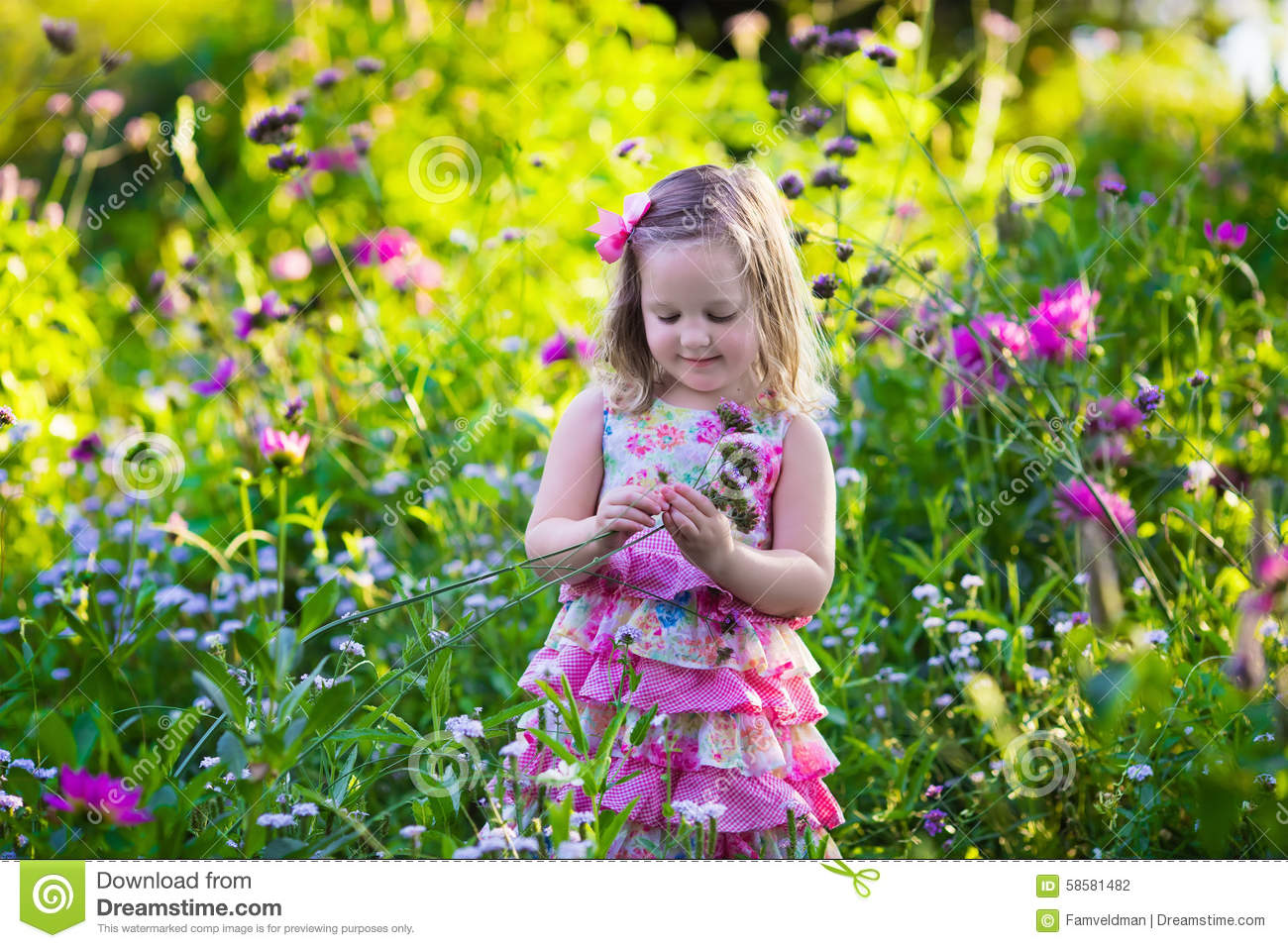 Royalty Free Stock Photo. Download Little Girl In Flower Garden ...