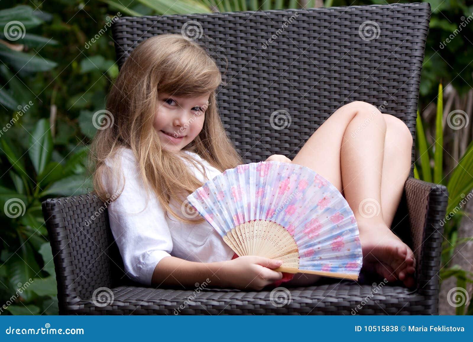 Little girl in the garden-chair