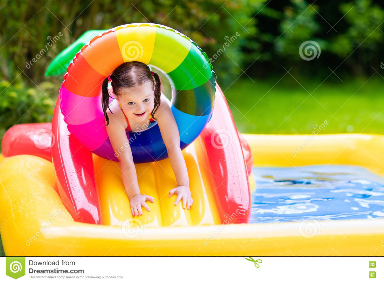 Little girl in garden swimming pool stock photo image for Kids swimming pool