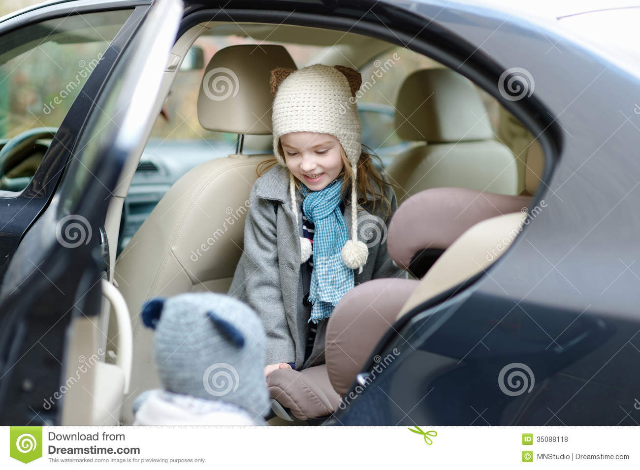 little girl getting into her car seat stock photo image 35088118. Black Bedroom Furniture Sets. Home Design Ideas